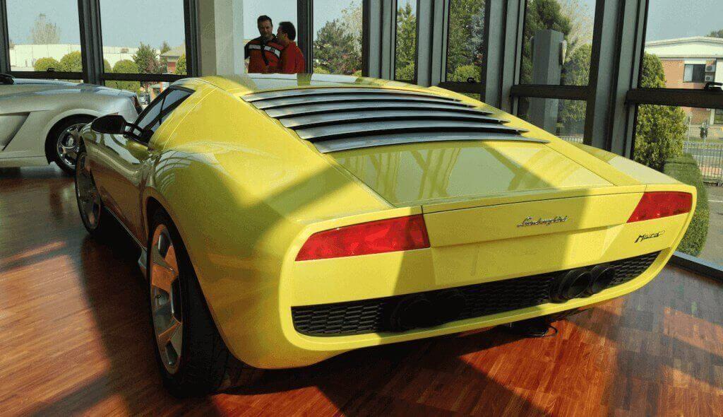yellow lamborghini in a car showroom in Italy
